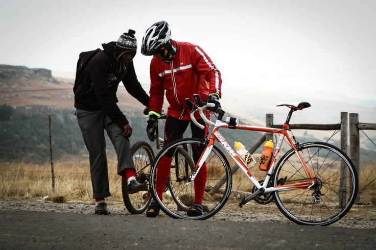 Seeing this young boy cycling to school in red socks just outside Mount Fletcher (snow capped mountains) was a special moment for me during Unogwaja 2012