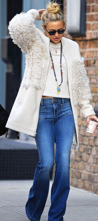 Kate Hudson channels Penny Lane in flare jeans, a cream top, and a Loeffler Randall shearling coat