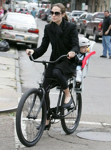 Angelina Jolie with her copilot child bike seat!