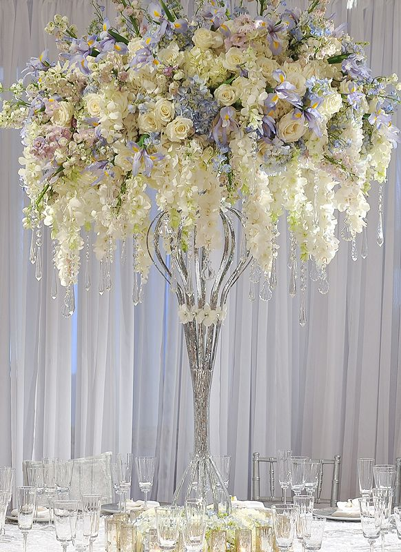 "Preston Bailey Designs, Cascading Centerpiece. This idea with a "" cleaner"" vase would make a huge impact in a simple room. Just needs up lighting or pin spotting. Light blue is hard to see at night in some venues"