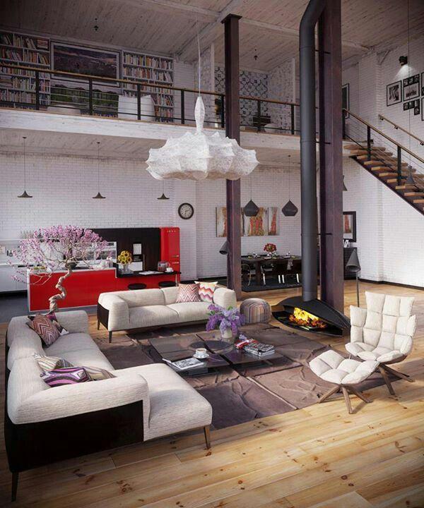suspended fireplace. upstairs office nook. worn wood floors