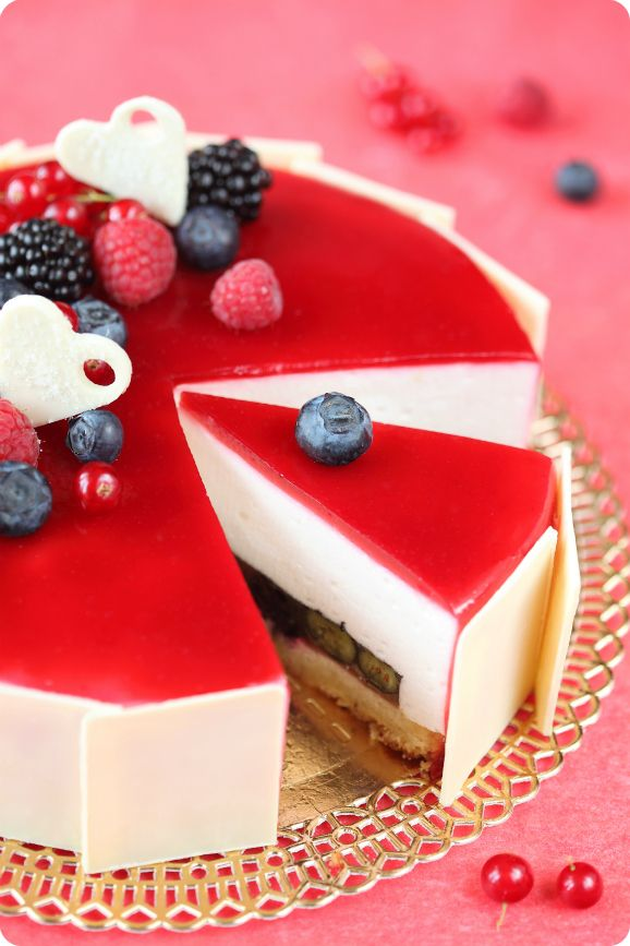 Coconut berries entremet - almond cake base, white wine jelly with berries, coconut mousse and raspberry mirror glaze.
