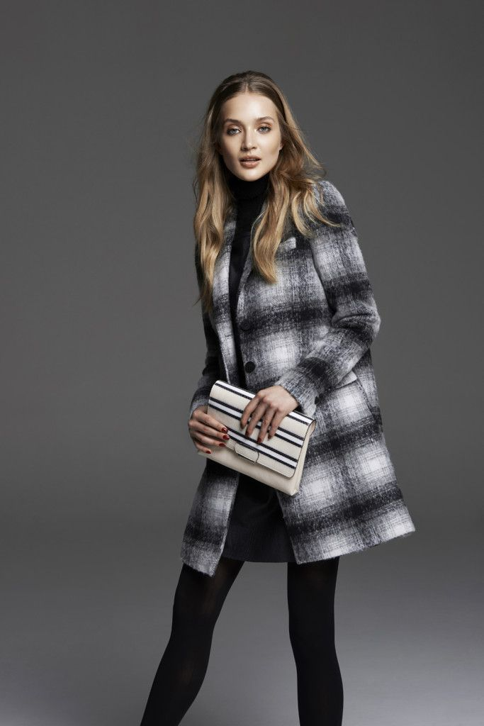 Checked wool coat and monochrome clutch