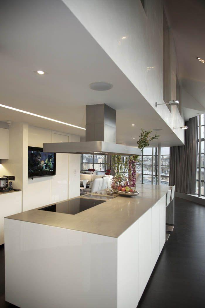 Minotti Inca kitchen in high gloss white, with silver quartzite worktops. Glass Building, Camden