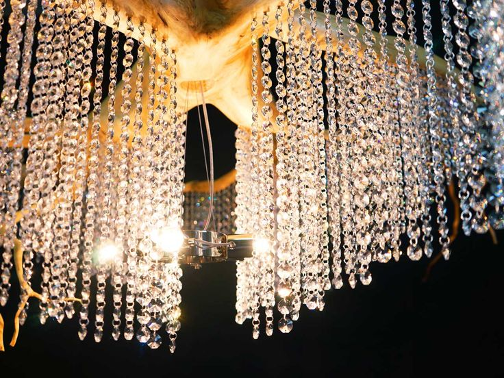 Root chandeliers adorned with the original Swarovski crystals
