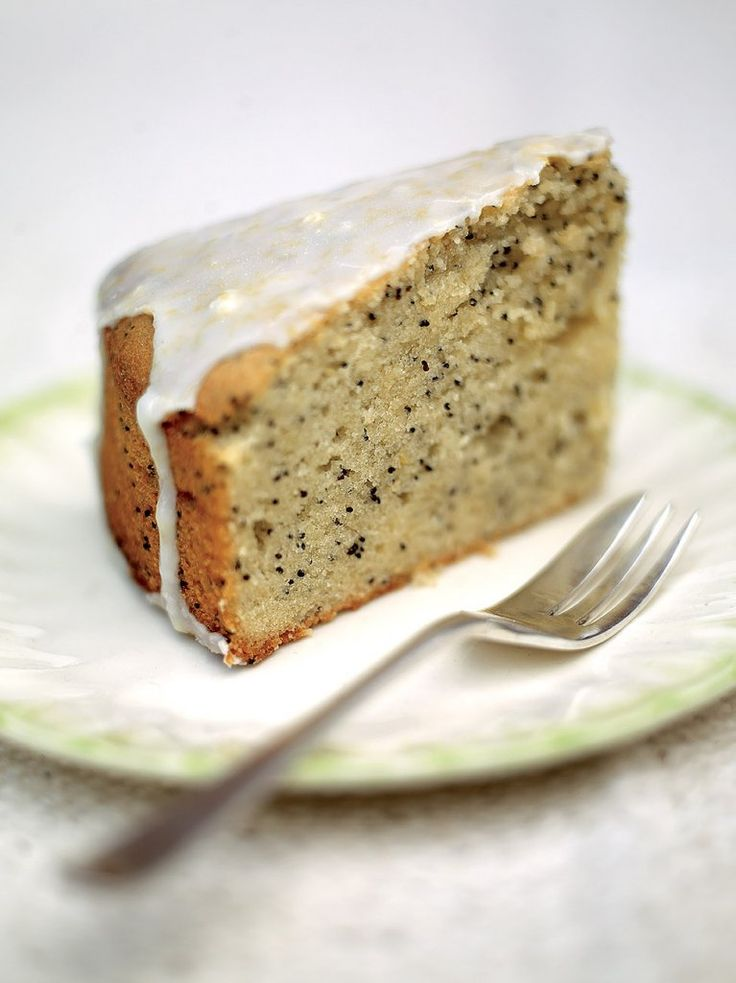 Lemon Drizzle Cake - scratch snack cake with ground almonds and poppy seeds and topped with lemon syrup and lemon glaze.