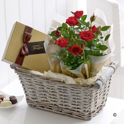 Rose & Chocolate Gift Basket Spoil them with an elegant gift of flowers and chocolates - we've chosen only the very best for this gift set. A beautiful flowering rose plant in ruby red is wrapped and presented with a stylish box of luxury chocolates. The pretty wicker basket makes a useful keepsake too. #GiftBasket #Roses Price: £26.99