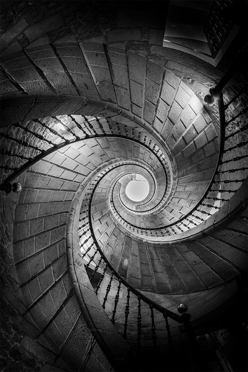Pinned - emphasis on the spiralling shape of the staircase, expressionistic lighting, draws onlookers to look at the center of the image.
