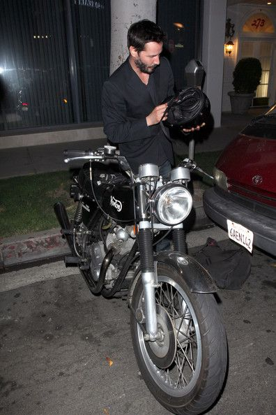 Keanu Reeves Photos Photos - Thursday September 22 2011..Keanu Reeves prepares to ride home on his vinatge Norton motorbike.after dining out at Spago in Beverly Hills. - Keanu Reeves Leaves Spago in Beverly Hills