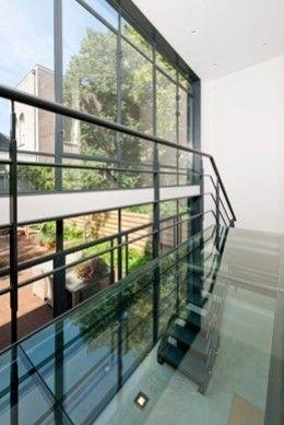 Stalen trap met glazen loopbrug, Vondelstraat | Kodde Architecten