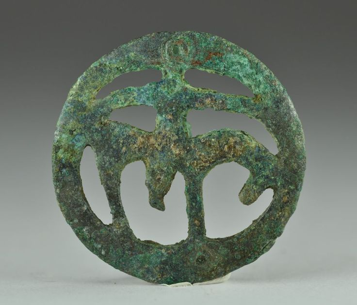 Amlash bronze horse fitting with horse, 1st millenium B.C. Amlash bronze horse fitting with horse, loop backside, 4 cm diameter. Private collection