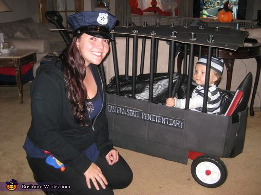 Dana: Mommy is the police officer and son is the inmate. We decorated his wagon to be a prison cell. We used PVC pipe as the bars and spray painted them...