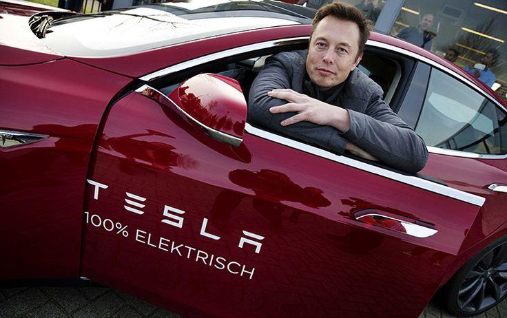 Elon Musk sitting in a Tesla Model S