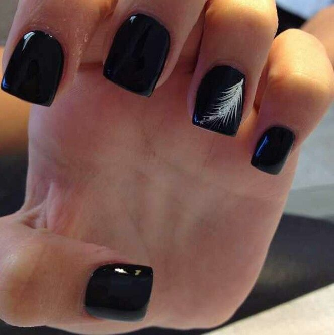 Black nails with a simple cute white feather