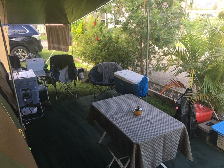 Camp dining and lounge area from under the EasyTarp FAMILY KIT #EasyTarp