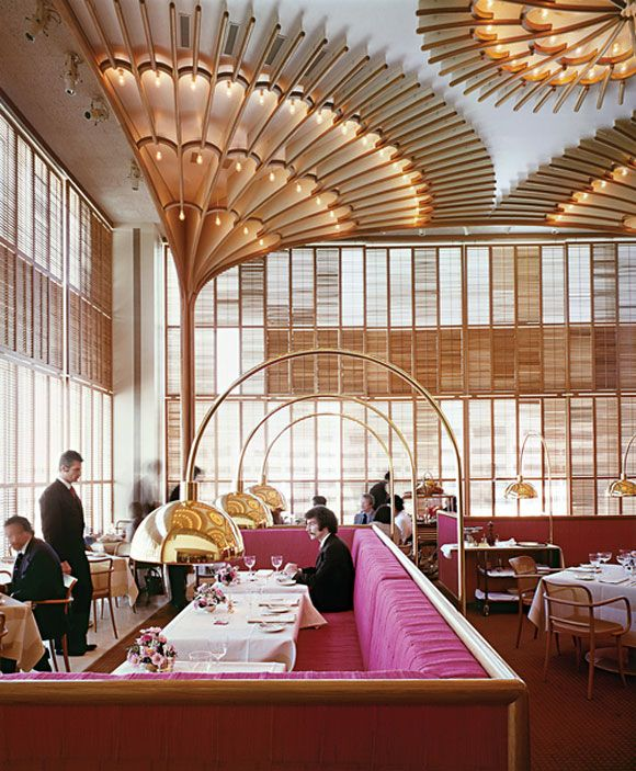 """Warren Platner designed the American Restaurant in Kansas City in 1974 as part of a complex of modern buildings commissioned by the Hall family of Hallmark Cards. He described the bentwood, brass and lipstick-red interior as """"like a huge lace Valentine."""" Image via dwel"""