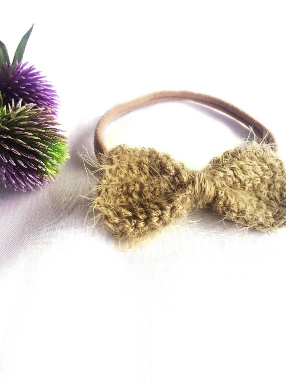 This soft as silk crochet bow is the perfect neutral colour to accessorise your bohemian babes outfits. Paired with the super soft and stretchy nylon headband, this hair accessory will not leave marks on your babys delicate skin.  These bows are approximately 6.5cm x 3.5cm The headband will stretch to fit up to an older child  Product Safety All young children should never be left unattended or left to sleep wearing any sort of headband or hair accessory. Please ensure product is fully…