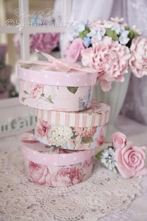 I have some floral and paisley hat boxes in shades of pink...it just means dismantling the storage in my bedroom. I also have a couple of floral magazine racks if we need them.