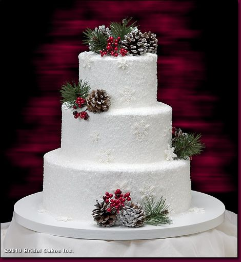 * so pretty *    crystal sugar is used to create the sparkly snow covered effect. Snow flakes, pine cones and berries give it an extra special touch.