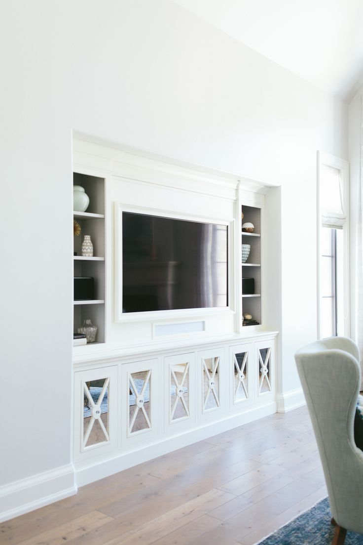 Living room built ins- architectural feature on cabinets, built in tv, shelving
