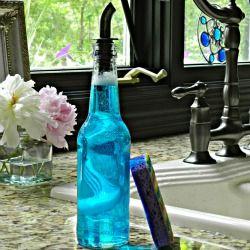 Beer bottle turned soap dispenser