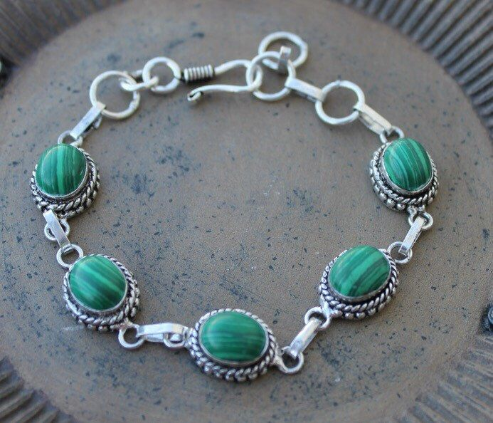 A personal favorite from my Etsy shop https://www.etsy.com/listing/253440928/antique-silver-malchite-gemstone