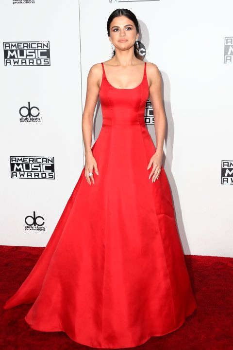 Selena Gomez stole the show with classic red carpet glamour in this red Prada gown at the American Music Awards. See all of the best dressed celebrities from the event here: http://www.harpersbazaar.co.uk/fashion/style-files/news/g37392/2016-american-music-awards-red-carpet/