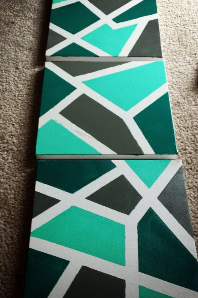I took three small canvas' and put painters tape over a few areas randomly. Then selected three different colors and painted each section. I let dry then pulled off the tape and voila! All done! Easy, yet fun!