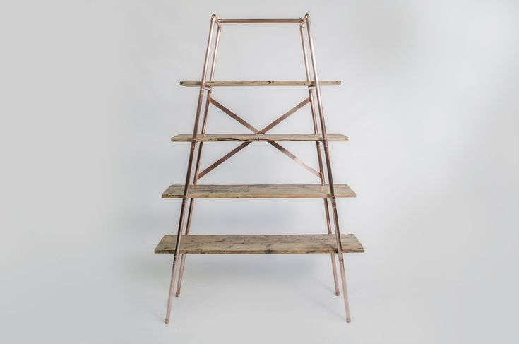 Free-standing copper pipe reclaimed wood shelving                                                                                                                                                                                 More