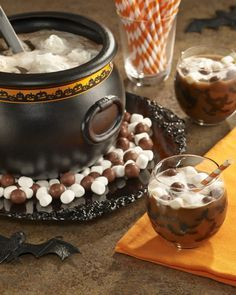 """Witches' Brew Chocolate Punch - A Halloween punch recipe of root beer combined with hot cocoa mix and Reddi-wip for """"murky"""" goodness. Perfect for a ghoulish kids or adult Halloween party."""