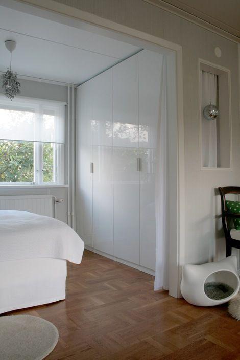 ikea pax wardrobe with high gloss Fardal doors and Klippig handles