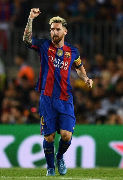 Lionel Messi of Barcelona celebrates scoring his sides first goal during the UEFA Champions League Group C match between FC Barcelona and Celtic FC at Camp Nou on September 13, 2016 in Barcelona, Catalonia.