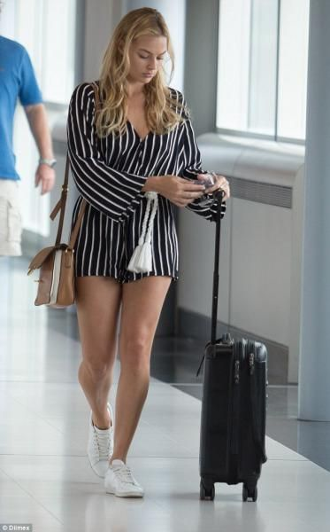 Margot Robbie wearing Faithfull the Brand Vision Playsuit in Tilbury Stripe and Victorinox Spectra Dual-Access Extra Capacity Carry on Luggage