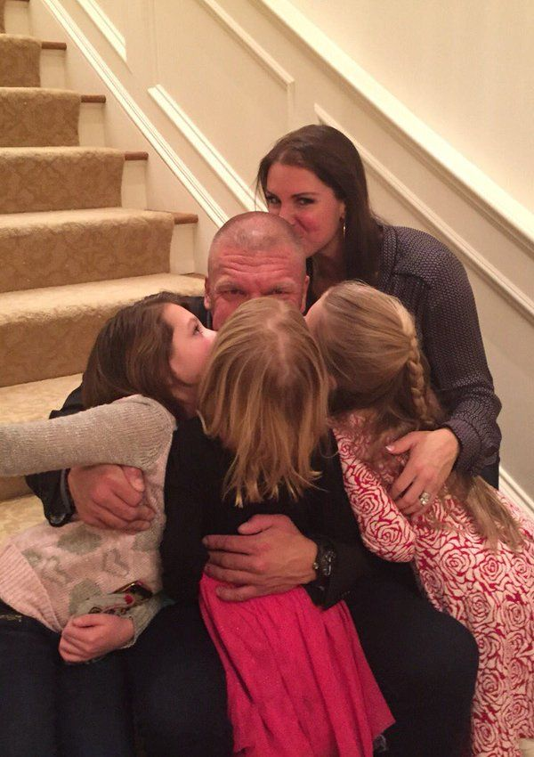 WWE World Heavyweight Champion Triple H getting Valentine's Day kisses from his wife Stephanie McMahon and daughters Aurora, Murphy, and Vaughn