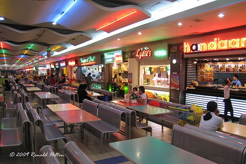 SM Mall of Asia Food Court by rhilton4u, via Flickr I'm in the Philippines writing my novel about a Filipino American woman who falls in love as she embarks on her dream to run her own fast food chicken place in a small California suburb. I've been SM in Cebu, but not this mall. I want to combine the look of older US malls w/ the look of this food court.