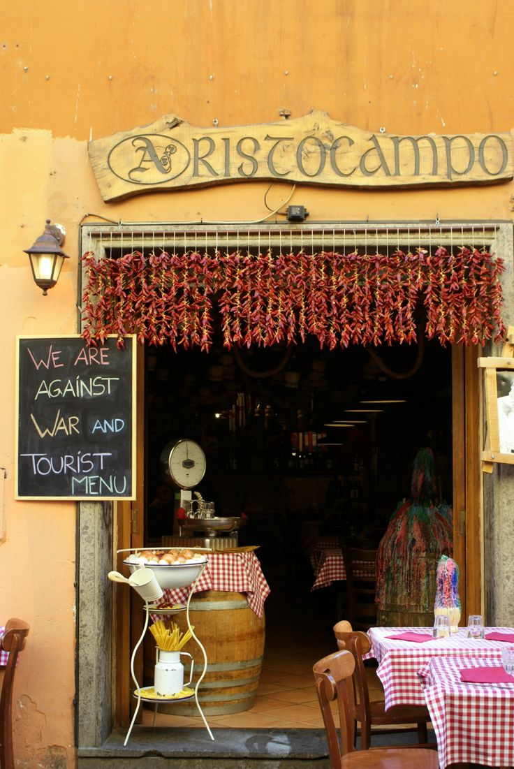 "The sign says ""We Are Against War and Tourist Menu"" 