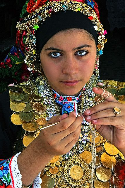 Greece | A young Karpathos woman in national costume crocheting | ©Patricia Fenn