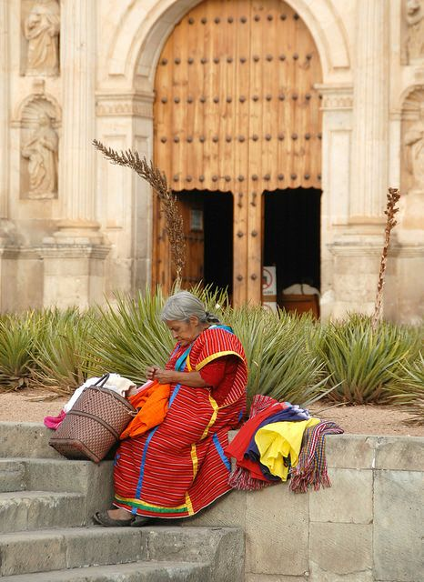 This woman from San Juan Copala (a Triqui community) takes a rest from selling textiles in the streets of Oaxaca, Mexico
