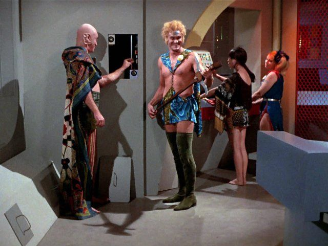 """Still of Phyllis Douglas, Deborah Downey, Skip Homeier and Charles Napier in Star Trek (1966) - the episode is """"The Way to Eden"""" (Charles Napier, here in the blonde wig and thigh-high boots, would go on to be in Silence of the Lambs, among other things)"""