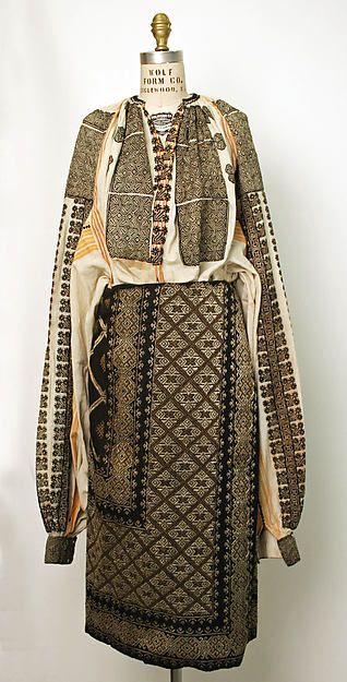Romanian Ensemble / ie / la blouse roumaine. . . Date: 19th century. . .  Culture: Romanian. . .  Medium: wool, cotton. . .  Dimensions: (a) Length at CB: 18 in. (45.7 cm) (b) Length at CB: 31 in. (78.7 cm) (c) Length: 144 in. (365.8 cm) (d) Length: 72 in. (182.9 cm). . . Credit Line: Gift of Mrs. Everett Tutchings, 1947
