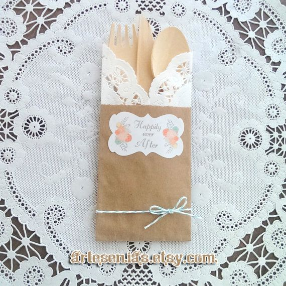 Rustic wedding utensil pockets, brown kraft bags, doilies, compostable wooden utensils for an eco-friendly reception, engagement celebration, rehearsal dinner, wedding shower, or any gathering!  These are decorated with our flourish stickers and baker's twine for an extra special presentation.  artesenias.etsy.com