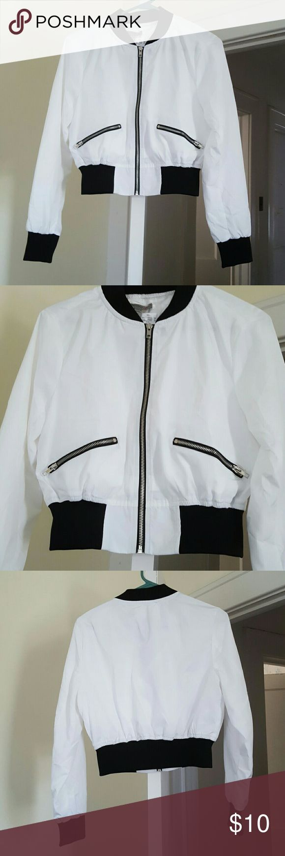 White and Black Bomber Jacket Lightweight Bomber Jacket purchased from Wet Seal is new with tags and never worn. Beautiful jacket and in excellent condition. Wet Seal Jackets & Coats
