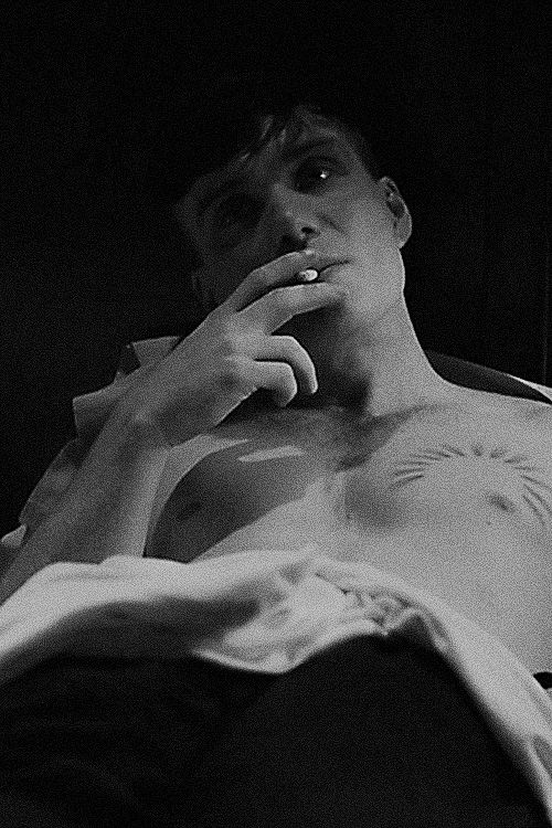 Tommy Shelby in bed smoking. Cillian Murphy.