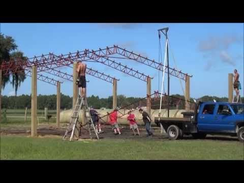 How to set steel pole barn trusses with a manual crane - YouTube
