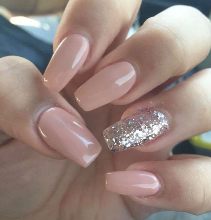 Nude or natural coffin shaped nails with one glitter nail