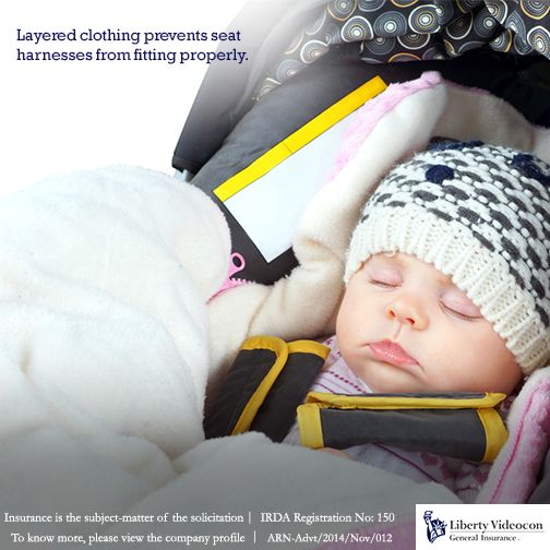 In winters, buckle your child into the car seat and then tuck a blanket around his body. #RoadTips