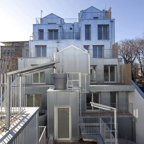 Shiny corrugated metal clads the two cascading stacks of apartments that make up this block inParisby architect Stephane Maupin.