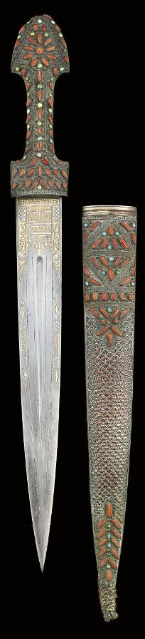 I was drawn to this because its a weapon, but at the same time its really pretty. This is a coral and turquoise inlaid ottoman dagger, Turkey, 18th century.