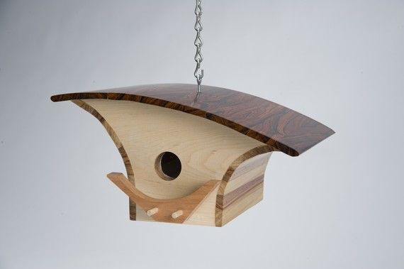 Using beautiful woods and curvy, sleek lines, these are not your average birdhouses.  #DesignMilk