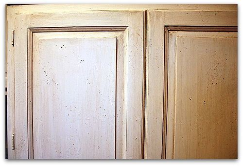Short cut way to repaint kitchen cabinets with no sanding, stripping or even removing the doors!